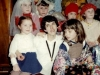 Purimshpiel in the Lifshitzs' apartment. Lena Romanovsky with children in actors costumes before performance. Leningrad, 1984,  co RS