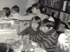Pesach in the Makushkin's apartment. Children are treating themselves. Leningrad, 1985(86?). co RS