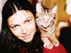 Sabina Levitzky (cousin of Natasha Utevsky) with her cat Monia. Leningrad, 197?, co RS