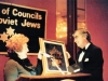 Lynn Singer hands in an award to ? at a meeting of the Union of Councils for Soviet Jews. USA, 19??. co RS